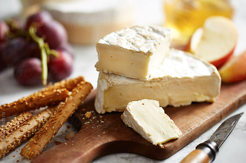 Camembert cheese with grapes by Martí Sans for Stocksy United