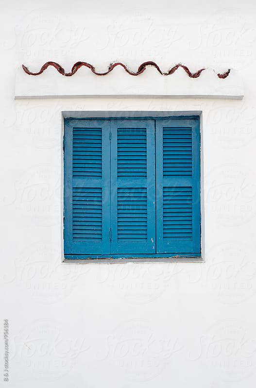Blue window by B & J for Stocksy United