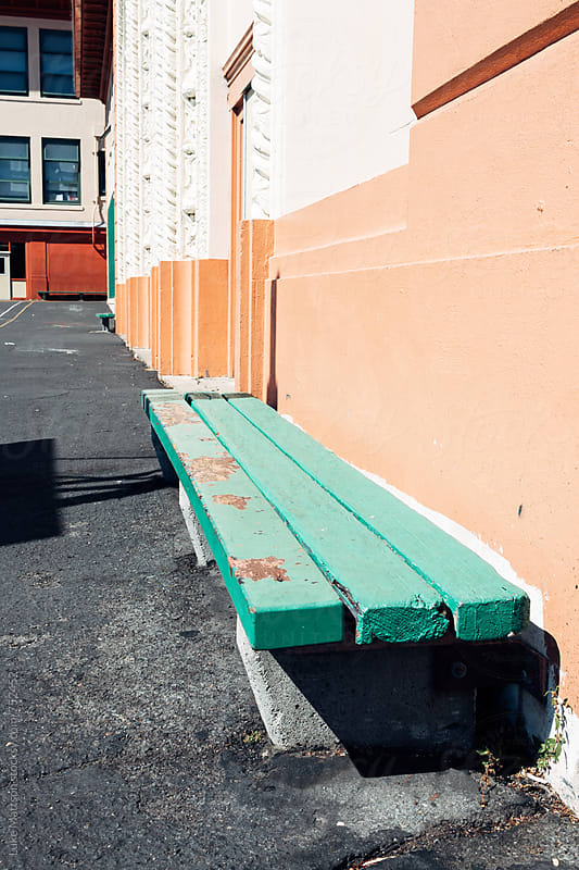 Green Bench With Peeling Paint Outside School Building by Luke Mattson for Stocksy United