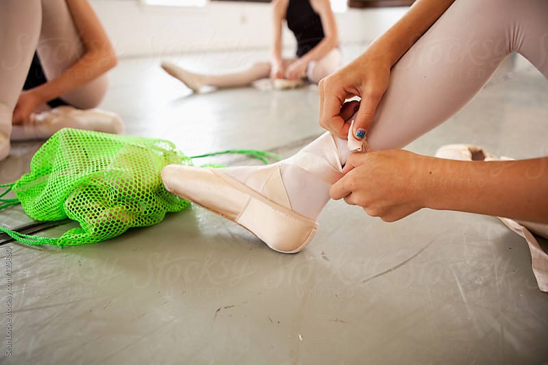 Ballet: Fixing Pointe Shoe Ribbon by Sean Locke for Stocksy United