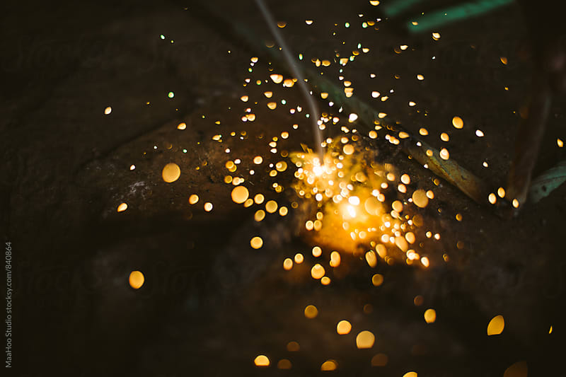 Sparks during welding by Maa Hoo for Stocksy United