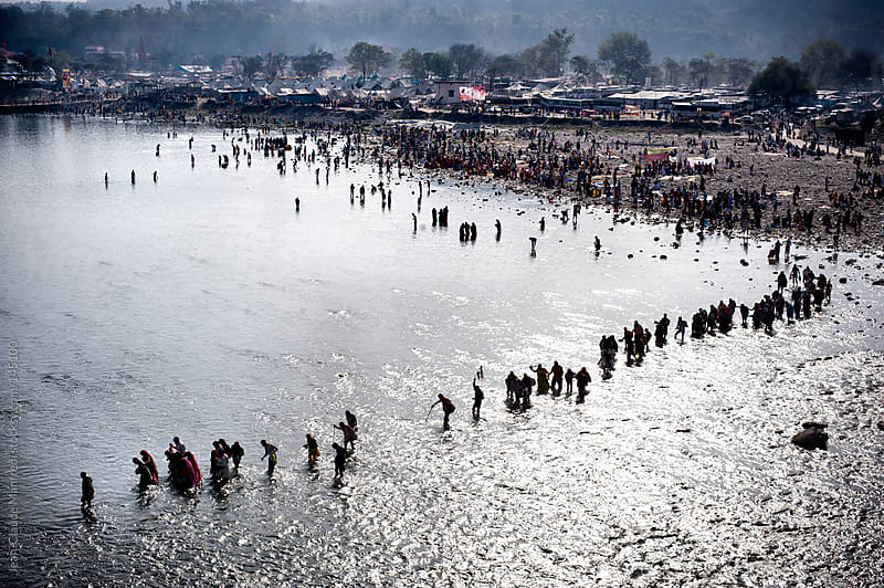 Hindu pilgrims crossing the Ganges River to arrive at Haridwar for the Kumbh Mela. by Jean-Claude Manfredi for Stocksy United