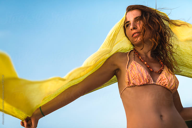 Woman With Scarf On a Beach by Alexander Grabchilev for Stocksy United