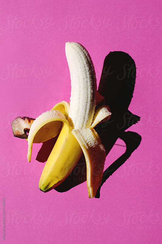 Banana on pink by Marcel for Stocksy United
