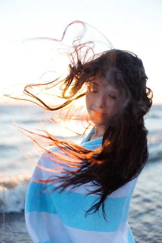 A young teenage girl at the beach by Chelsea Victoria for Stocksy United