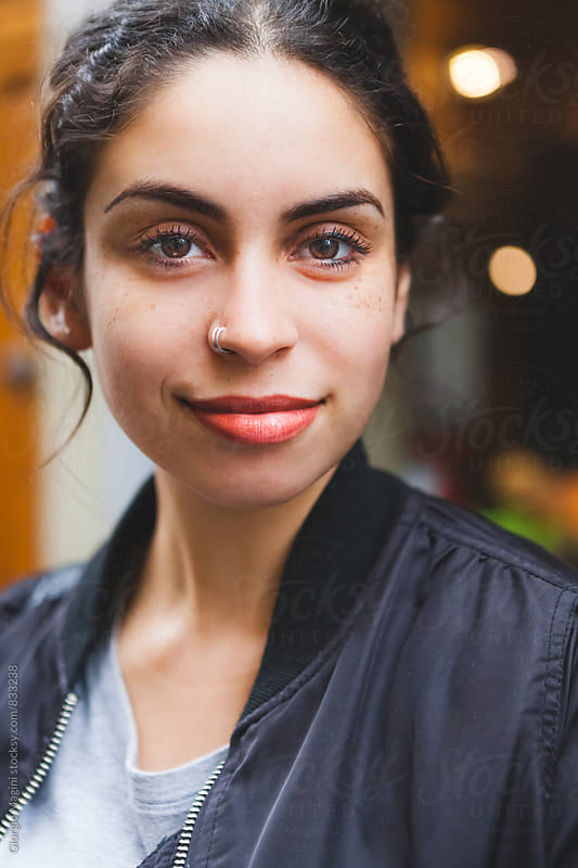 Candid Portrait of a Smiling Mixed Race Girl by Giorgio Magini for Stocksy United