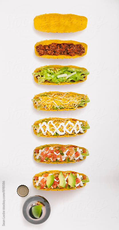 Series Of Hard Shell Tacos Being Built by Sean Locke for Stocksy United