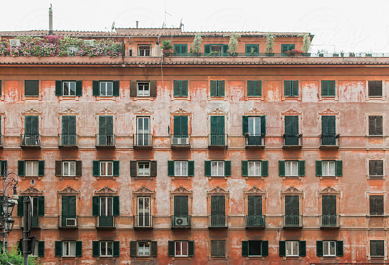 An Old Roman Building with Many Doors and Windows by Briana Morrison for Stocksy United