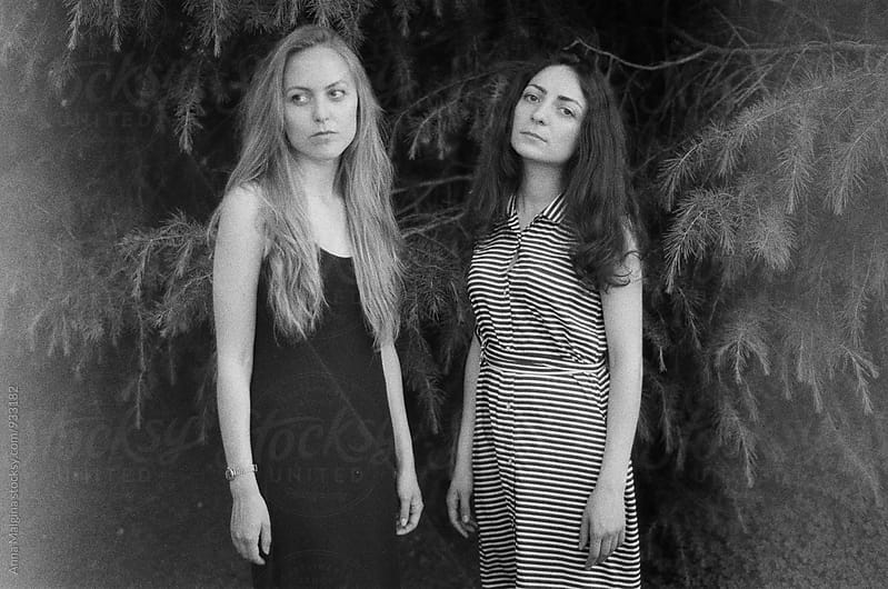A black and white film portrait of two beautiful woman by Anna Malgina for Stocksy United