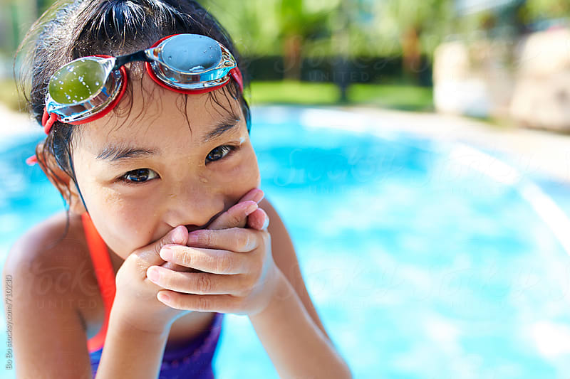 close up of one happy asian little girl in swimming pool by cuiyan Liu for Stocksy United
