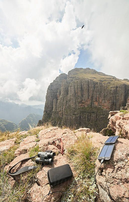 Solar power, binoculars and sunglasses in the mountains by Jacques van Zyl for Stocksy United