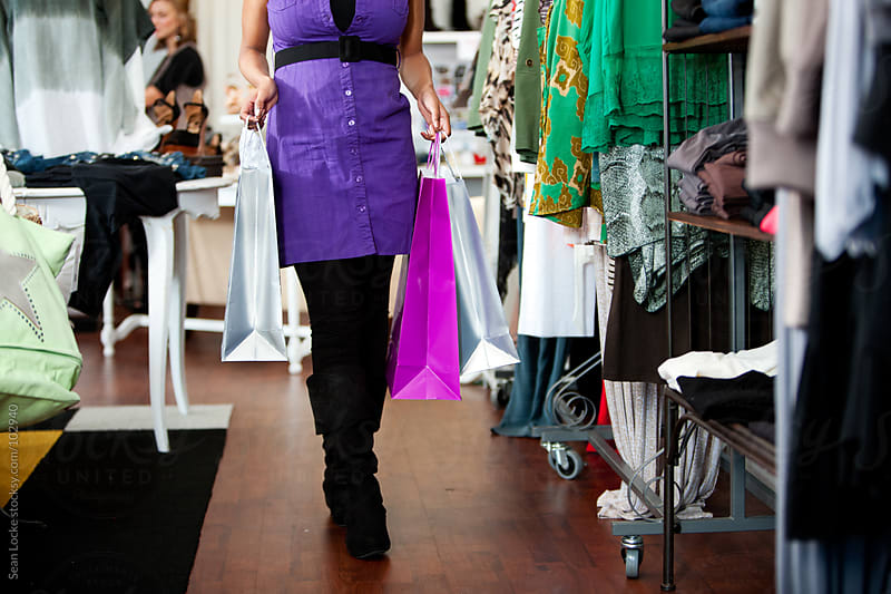 Boutique: Carrying Shopping Bags Through Boutique by Sean Locke for Stocksy United