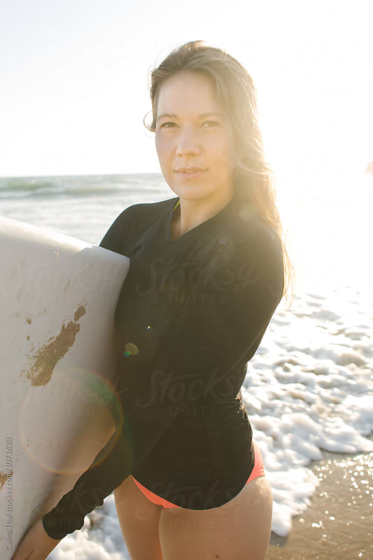 Pretty Girl Surfing on the Beach in Summer by Caleb Thal for Stocksy United
