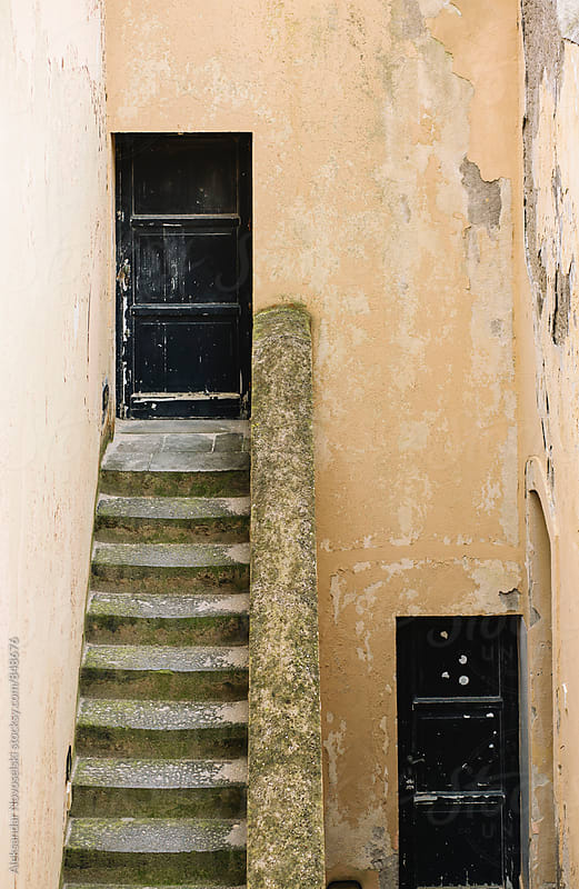Minimalistic shot of two doors and stairs in Italy by Aleksandar Novoselski for Stocksy United