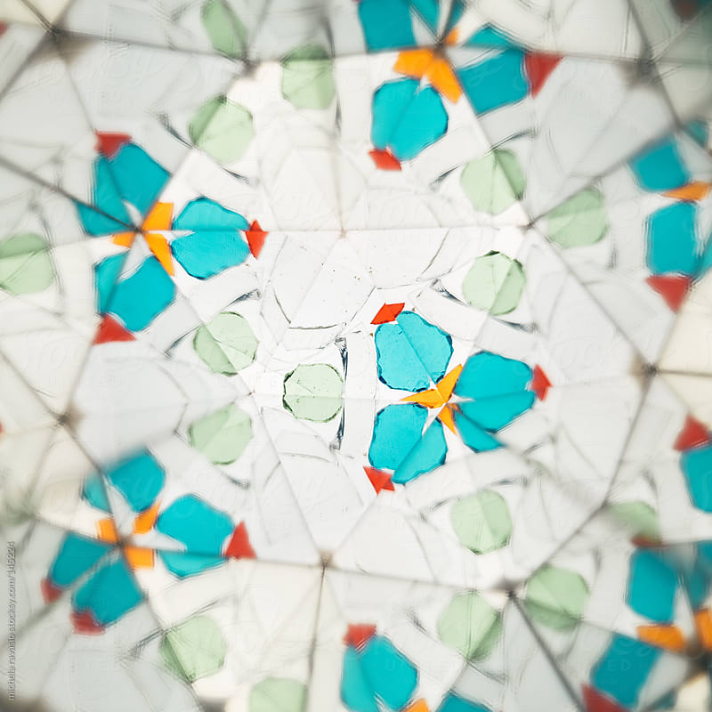 Pieces of colored glass seen through a kaleidoscope by michela ravasio for Stocksy United