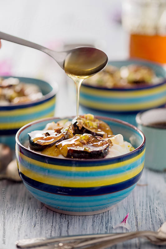 Dirzzling Honey on Yogurt with Roasted Figs by Studio Six for Stocksy United