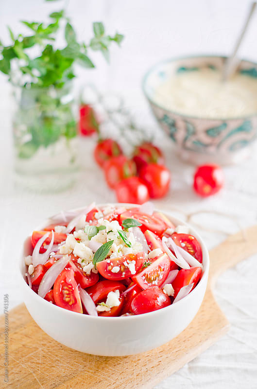 starters: turkish alp soup and tomato salad by Canan Czemmel for Stocksy United