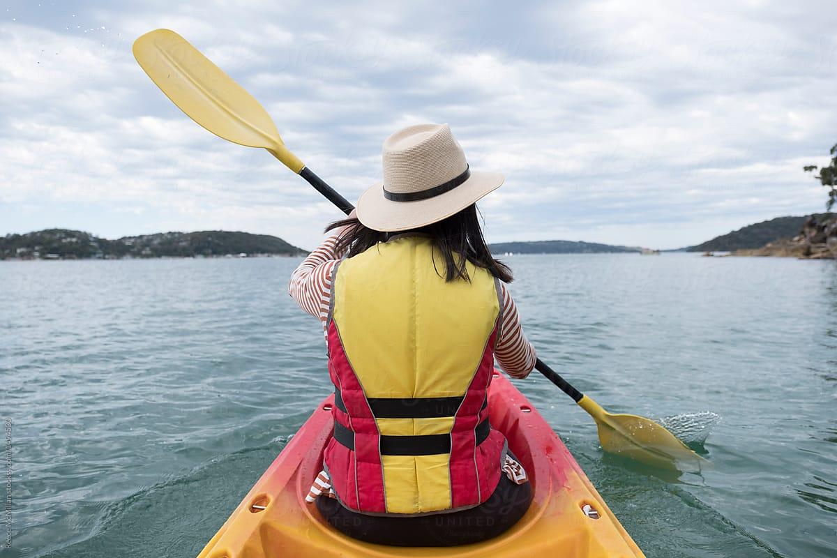 a woman kayaking around palm beach stocksy united