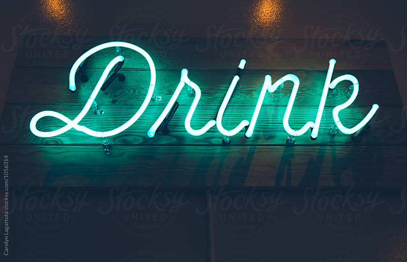 Illuminated sign that says Drink by Carolyn Lagattuta for Stocksy United
