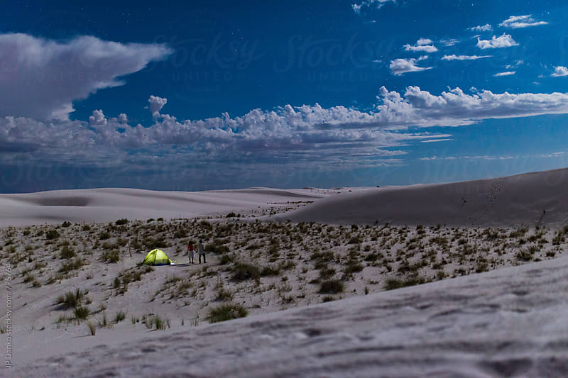Couple Holding Hands Looking at Stars Backcountry Camping White Sands National Monument New Mexico by JP Danko for Stocksy United