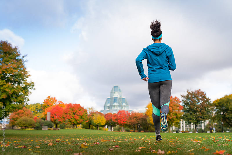 Fit Young Woman Jogging In Ottawa Park Near Parliament Hill by JP Danko for Stocksy United