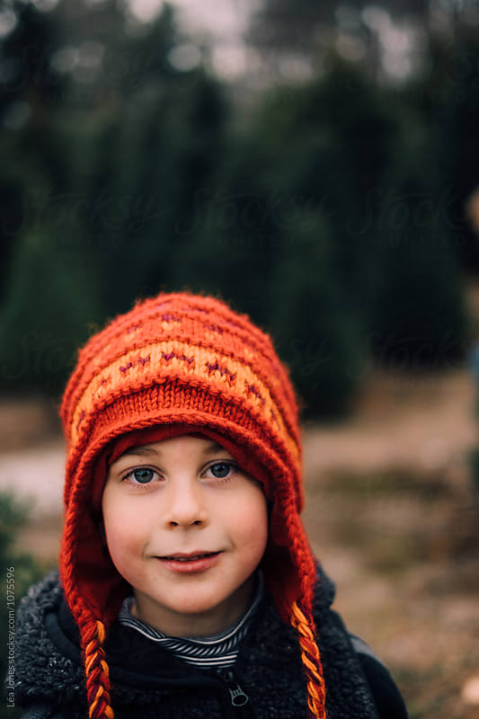 child with big wooly orange hat by Léa Jones for Stocksy United
