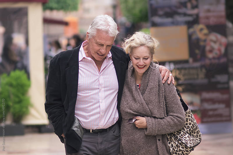 Happy mature couple in love, walking.  by Per Swantesson for Stocksy United