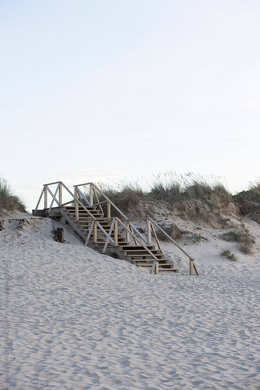 Beach access wooden stairs in the sunset by Marta Muñoz-Calero Calderon for Stocksy United