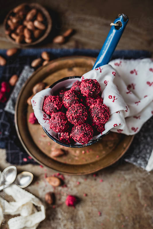 Homemade chocolate truffles with dried raspberries by Tatjana Ristanic for Stocksy United