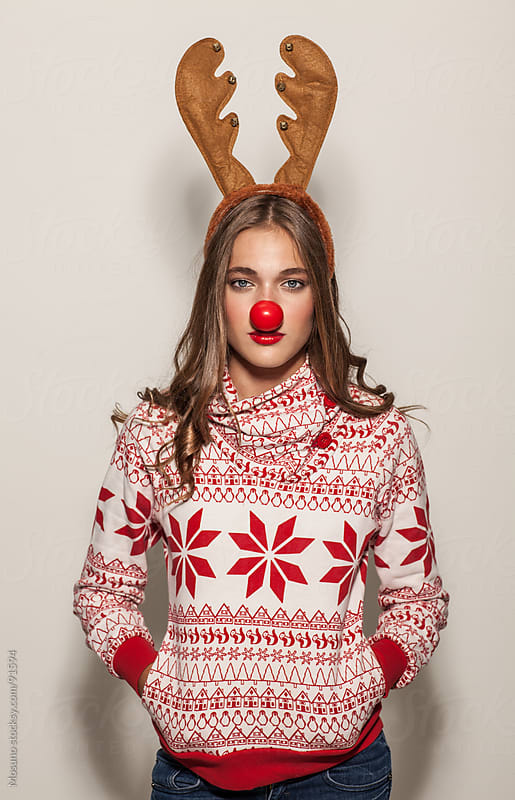 Woman With Reindeer Horns and Red Nose by Mosuno for Stocksy United