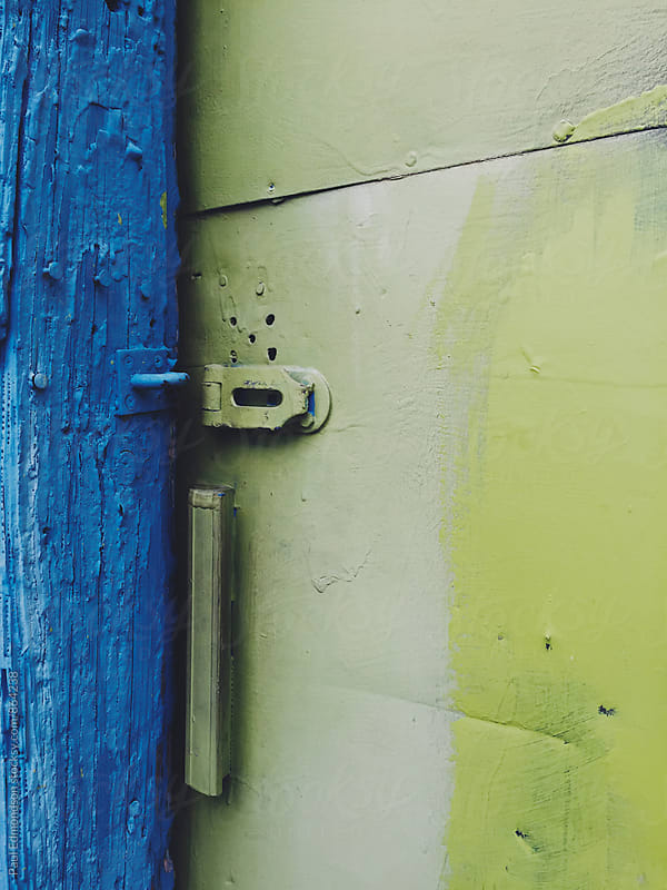 Close up of colorfully painted warehouse door by Paul Edmondson for Stocksy United