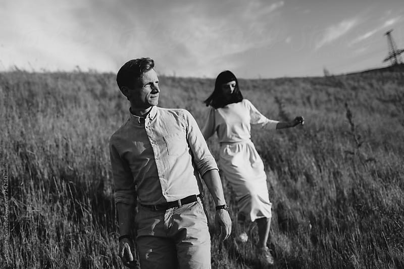Young couple going down the hill by Evgenij Yulkin for Stocksy United