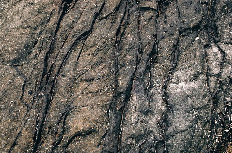 Black/gray sandstone formations; grungy texture/background by Wizemark for Stocksy United
