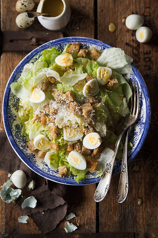 Ceasar salad with quail eggs by Török-Bognár Renáta for Stocksy United