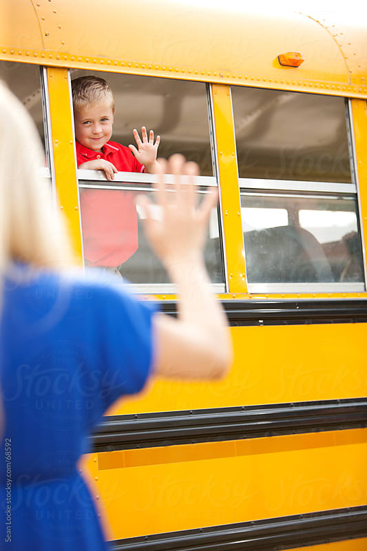 School Bus: Mom Waves Goodbye to Child by Sean Locke for Stocksy United