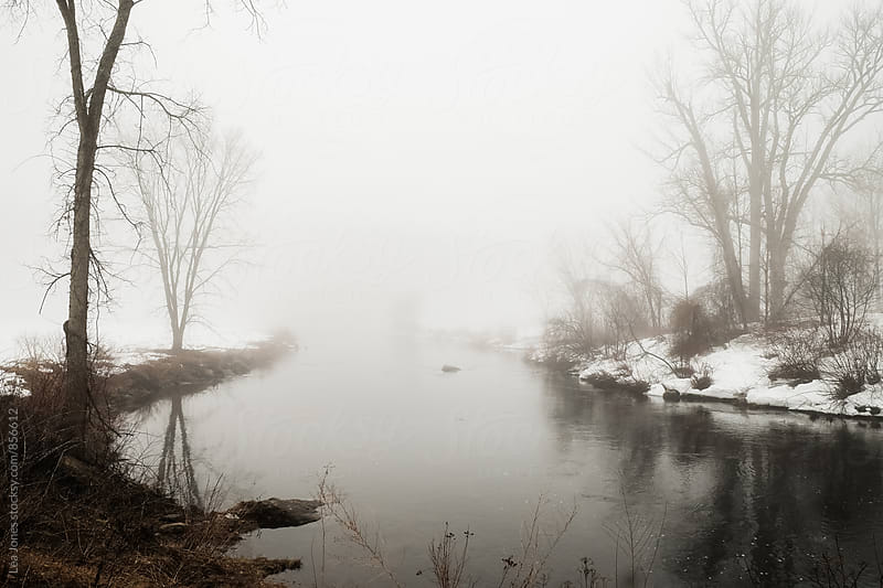 River in the fog by Léa Jones for Stocksy United