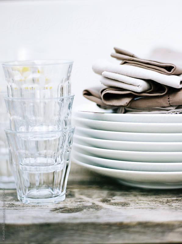 glasses and plates by Kirstin Mckee for Stocksy United