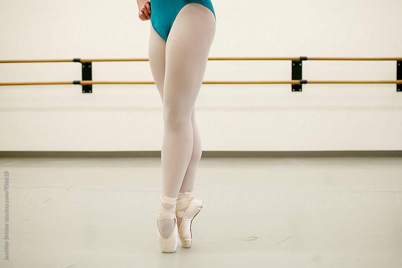 Ballet dancer's legs  by Jen Brister for Stocksy United