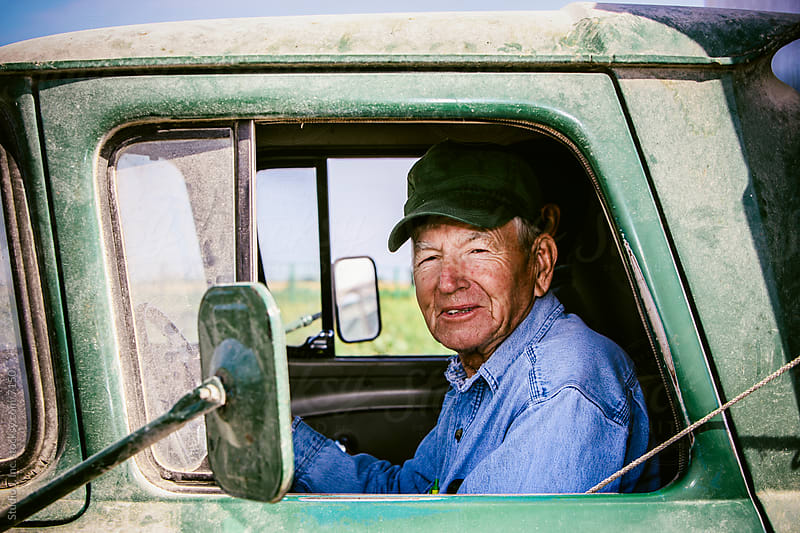 Americana: Old Midwestern Farmer in Dusty Pick Up Truck by Studio J, Inc. for Stocksy United