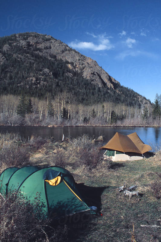 tents of backpackers near a pond in Lost Creek Wilderness Colorado Rockies in spring by Ron Mellott for Stocksy United