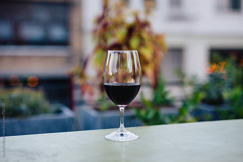 Red wine on the patio by Danny Pellissier for Stocksy United