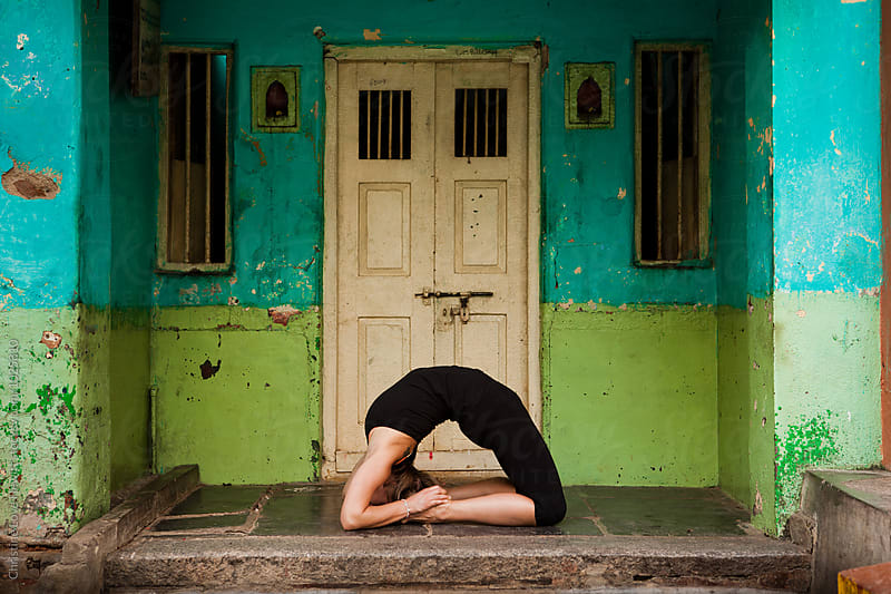 Woman doing yoga by Christine Hewitt for Stocksy United