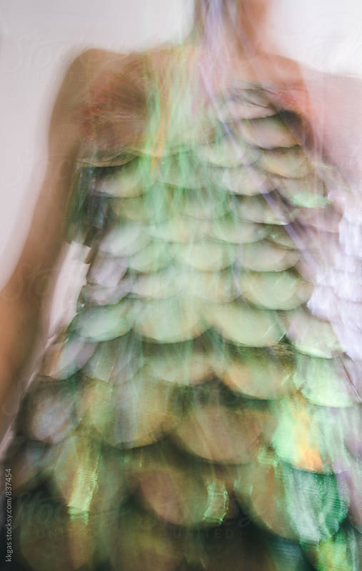Long exposure with motion blur of an iridescent layered costume by kkgas for Stocksy United