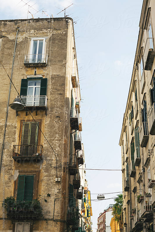 Typical buildings in italian street in Naples, on a sunny day by Aleksandar Novoselski for Stocksy United