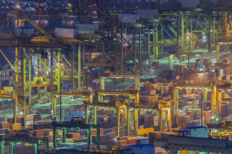 Busy Container Port at Night by Tom Uhlenberg for Stocksy United