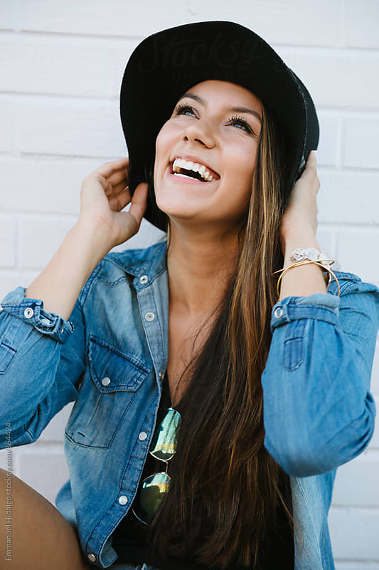 Cute and trendy young woman smiling by Emmanuel Hidalgo for Stocksy United