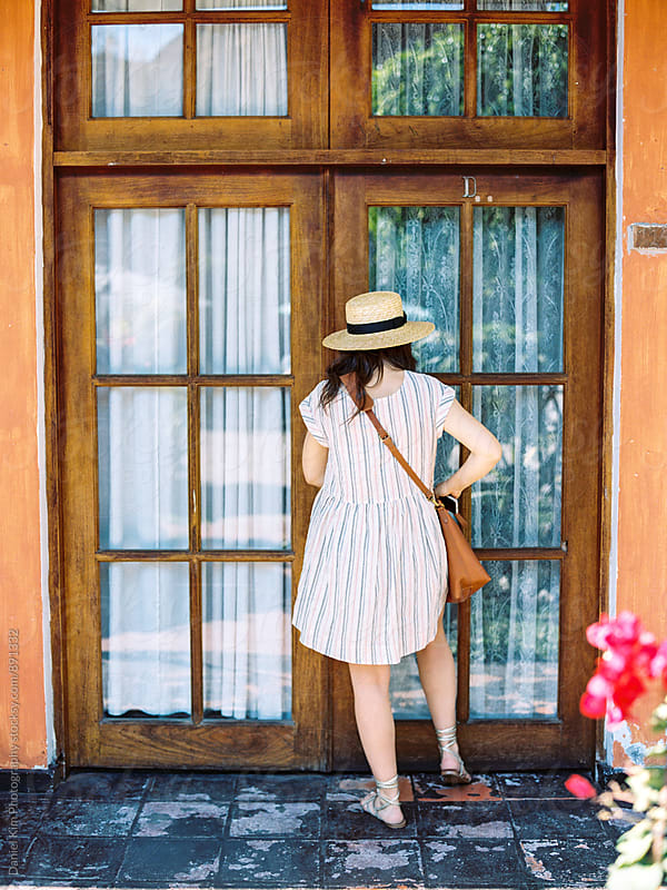Woman entering door by Daniel Kim Photography for Stocksy United