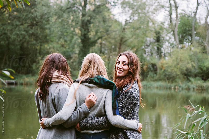 3 teenage friends in the countryside.  by Helen Rushbrook for Stocksy United