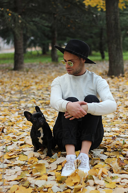 portrait of a young male owner and his little french bulldog by Branislava Živić for Stocksy United