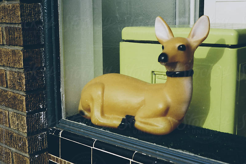 Small toy deer in shop window, Dublin, Ireland by Paul Edmondson for Stocksy United